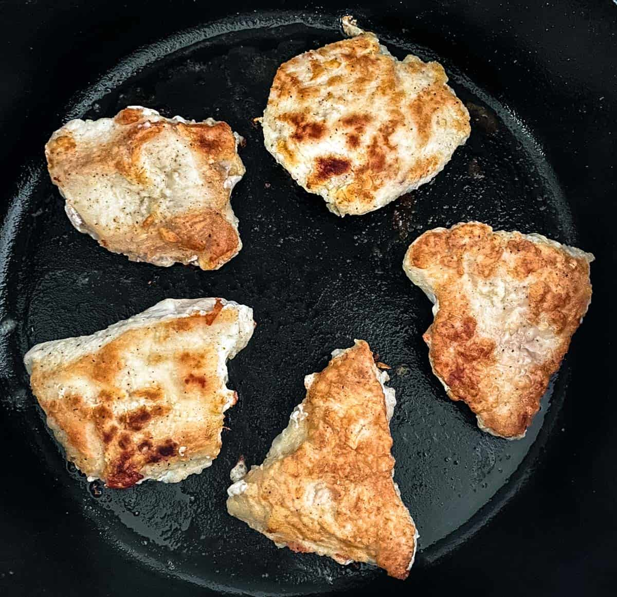 cooked chicken in skillet