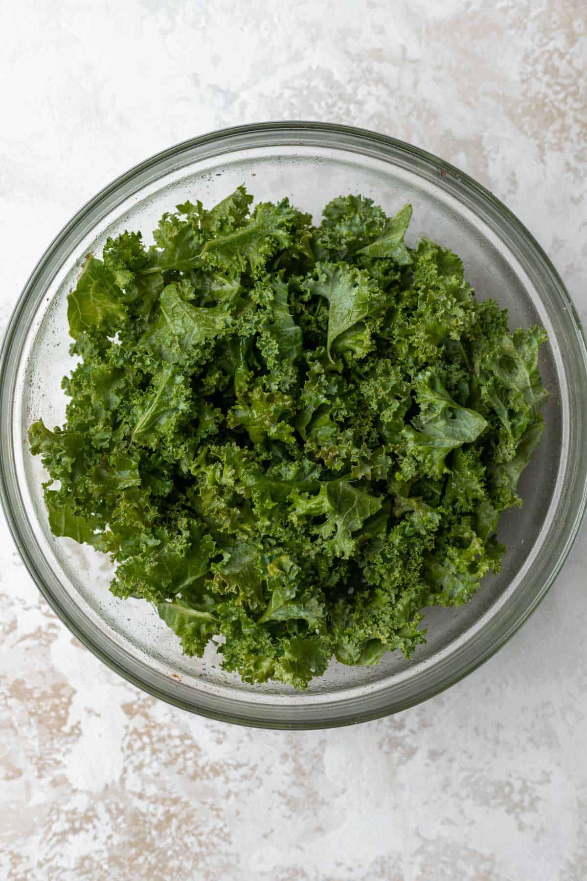 Chopped kale in a glass bowl.