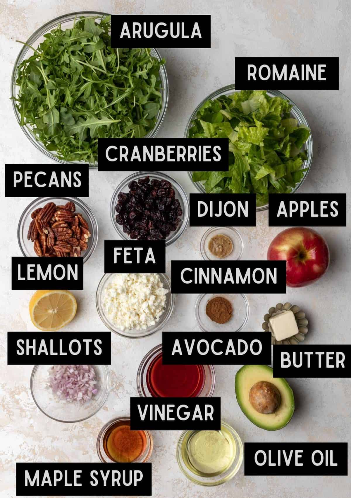 Labelled ingredients for apple, avocado, and arugula salad (see recipe for details).