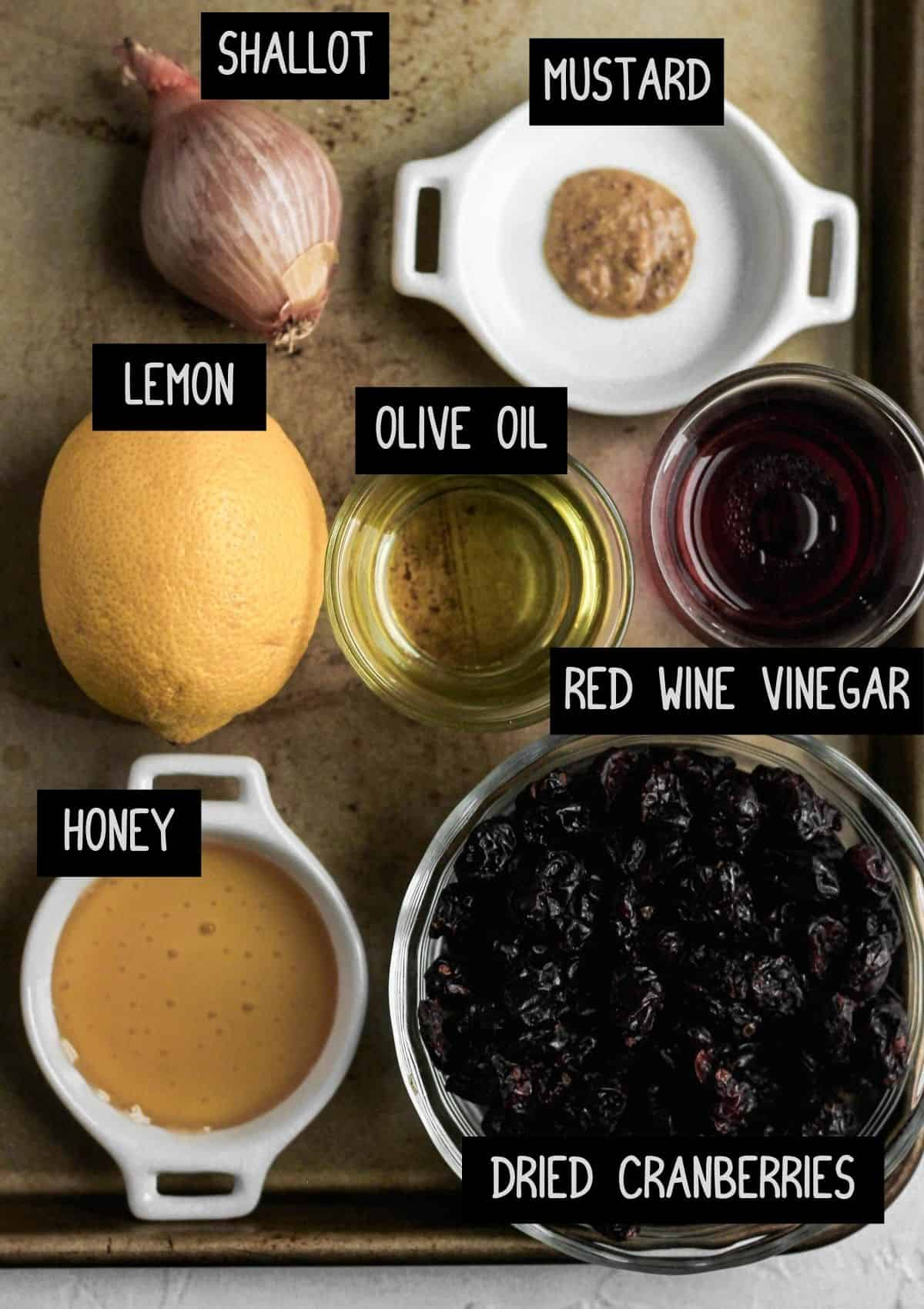 Labelled ingredients for the warm cranberry vinaigrette (see recipe for details).