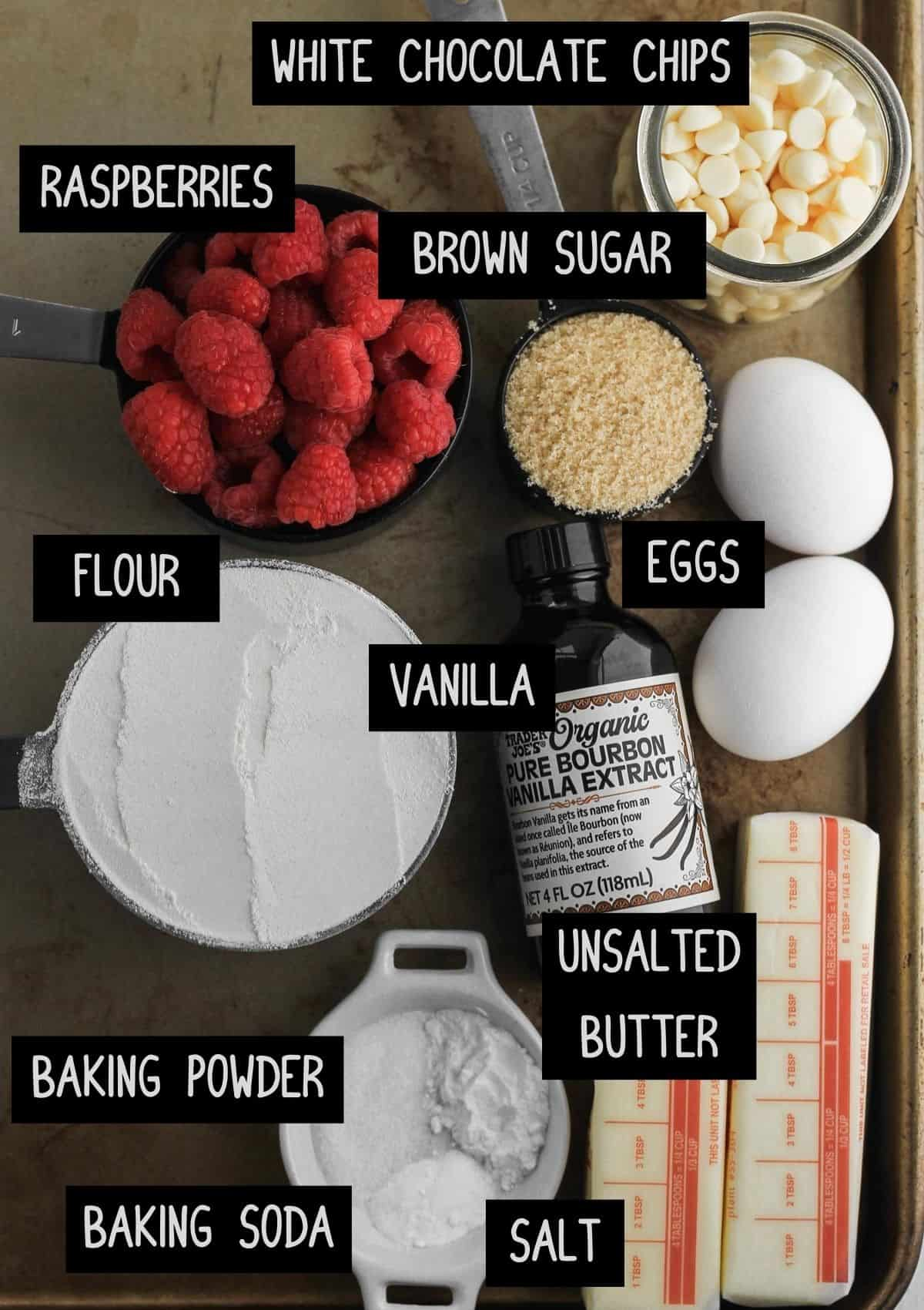 Labelled ingredients for raspberry and white chocolate blondies (see recipe for details).