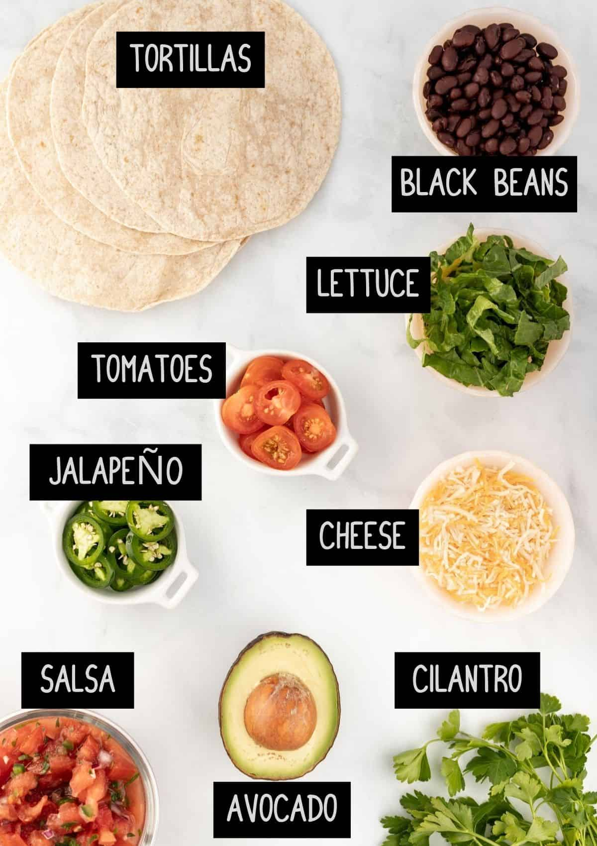 Labelled ingredients for topping fajitas (see recipe for details).