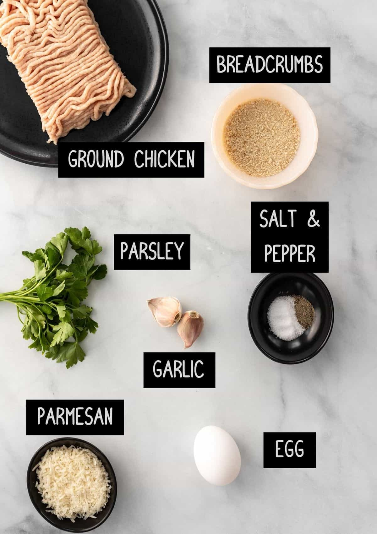 Labelled ingredients for the chicken meatballs (see recipe for details).