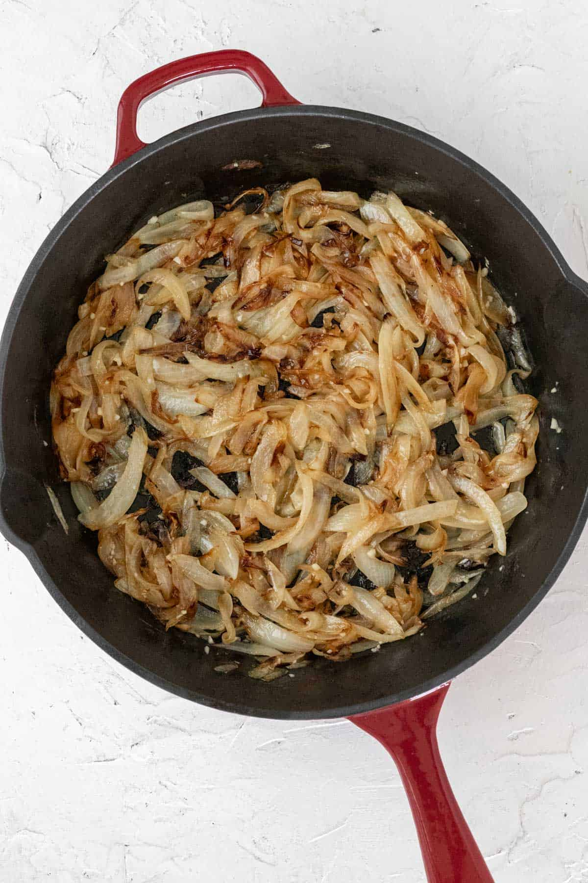 Caramelized onions in a cast iron skillet.