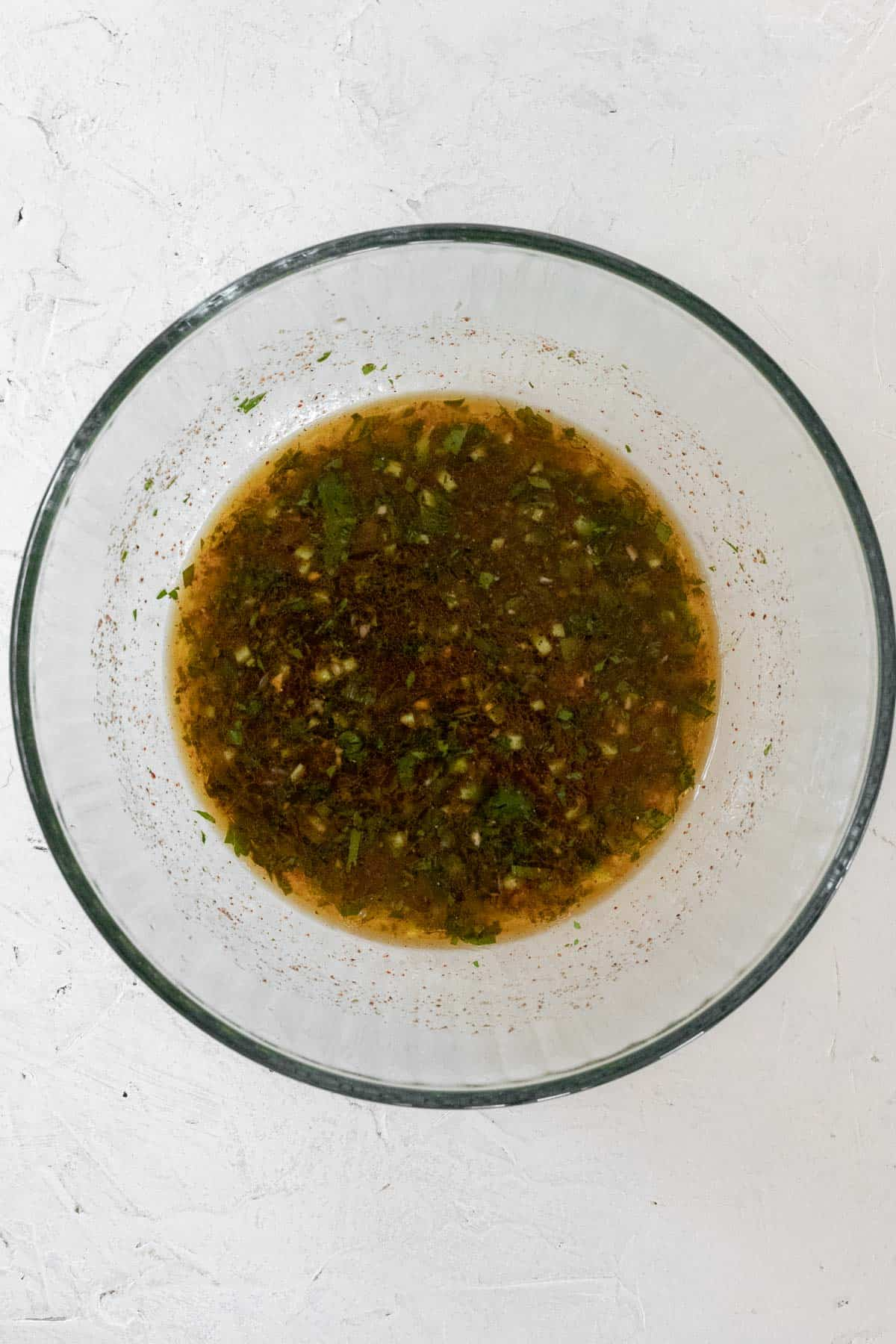 Tequila lime marinade in a glass bowl.