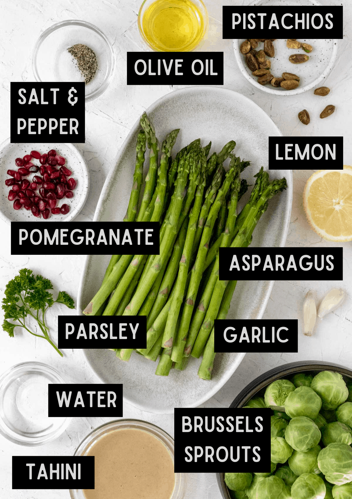 Labelled ingredients for roasted asparagus, brussels sprouts, and lemon tahini sauce (see recipe for details).