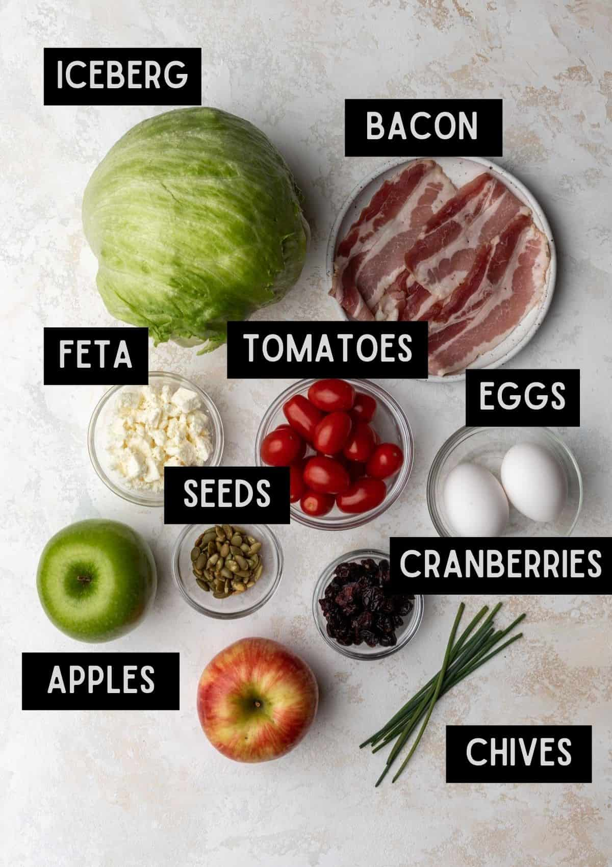 Labelled ingredients for fall cobb wedge salad (see recipe for details).